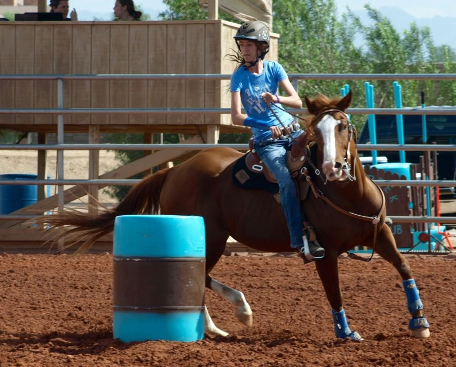 Freshman Hope Doyle races with her horse, Solye last month.