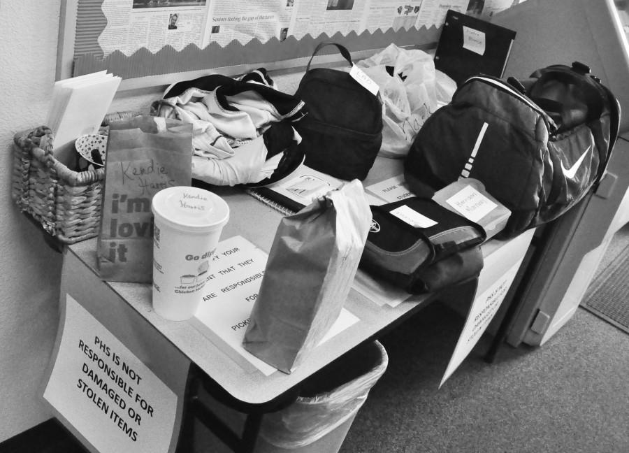 Perrys attendance office houses a table filled with items forgotten by students but brought to them by their parents.