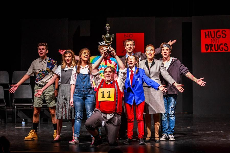 The Putnam County Spelling Bee cast showcased their play Nov. 5-7. Jakob Wilcoxson holds up a trophy, foreshadowing  their future state win.