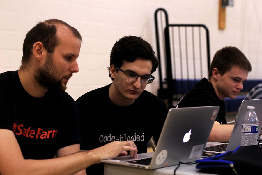 (From left) State Farm mentor Robert Buckley, Maurice Ajluni (12), and Dustin Howarth (12) at Perry High Schools 1st Annual JAVA Hack-a-Thon, April 9, 2016.