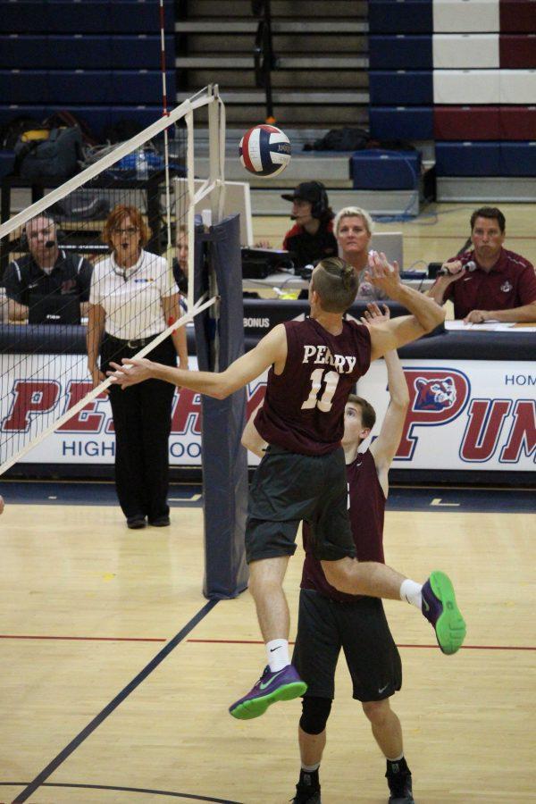 Senior Garrett Wagner hits the ball over the net