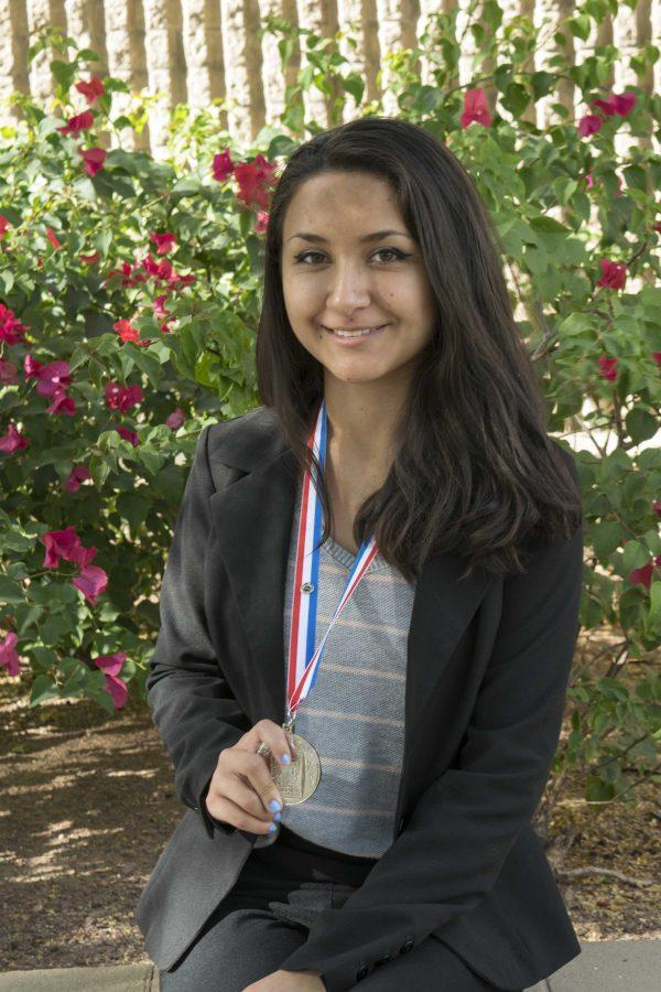 Junior Nikki Galvez poses with her second place medal.
