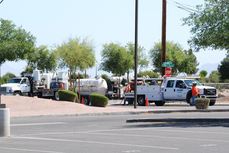 Construction workers putting up the new traffic light on 156th St. and Queen Creek.
