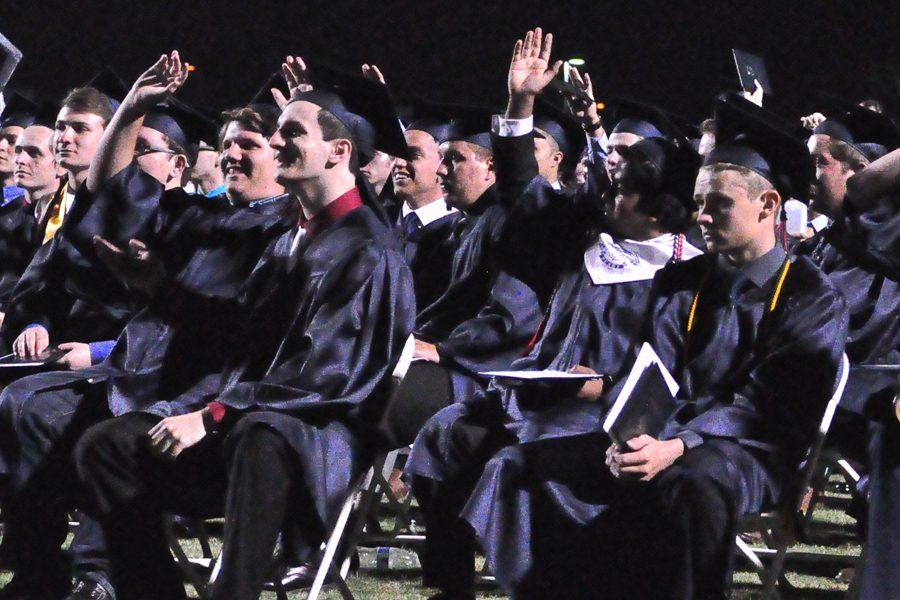 Students respond to a question during the valedictorian speech.