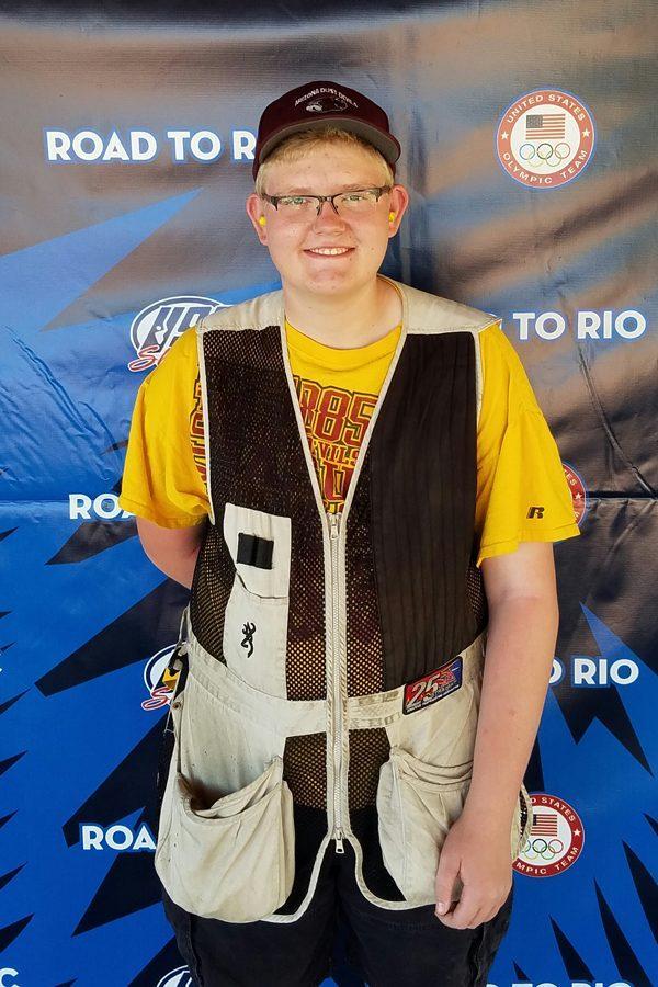 Junior Robert Pike poses for photo during Junior Olympics
