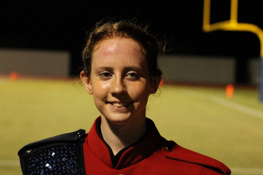 Freshman Jenny Van Dusen completes marching band performance during halftime