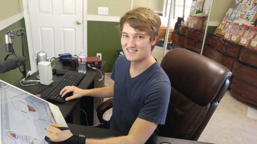 Youtuber James Rallison working on his comics.