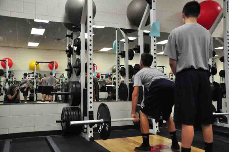 Football Players weightlifting in preparation for the competition