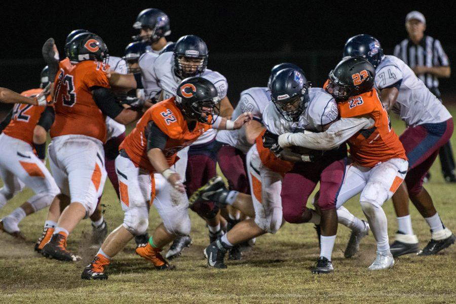 Sophmore RB, Jalen Young (10), plows through Corona defenders in the away game against the Aztecs on September 17, 2016. Photo by Thomas Richardson