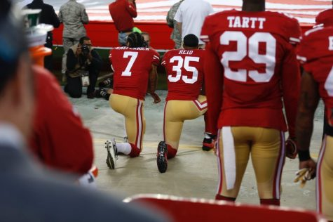 San Francisco 49ers quarterback Colin Kaepernick (7) kneels during the National Anthem before their game against the Los Angeles Rams for their NFL game at Levi's Stadium in Santa Clara, Calif., on Monday, Sept. 12, 2016. (Nhat V. Meyer/Bay Area News Group)