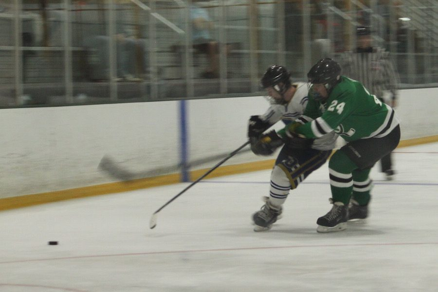 Senior Defenseman Bo Hannon (Perry) drives an attacker wide. Perry/Basha Hockey team defeated Notre Dame Prep on Oct. 23 with a score of 3-2.
