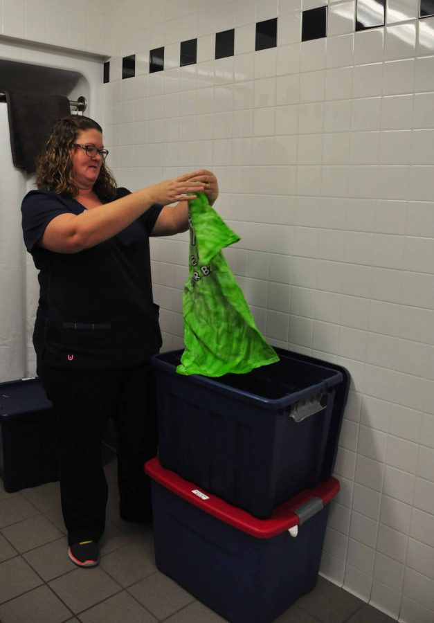 Nurse reveals box of clothing dress coded students change into.