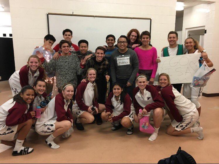 The Perry Pretty Decents pose with the senior members of the girls basketball team