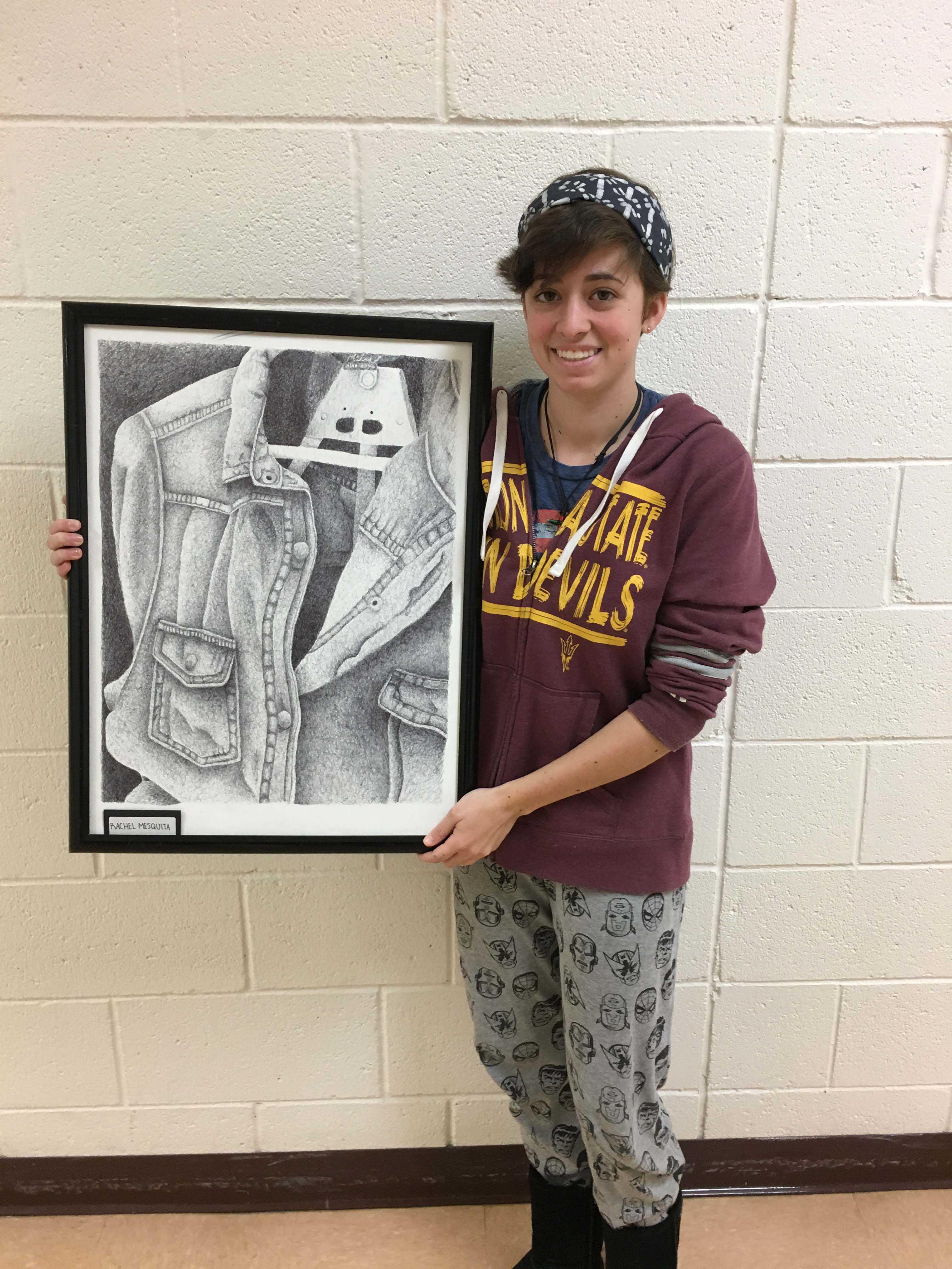 Rachel Mesquita holding her WinterFest art piece.