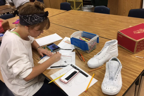 Sasha Rodriguez sketching out her shoe design.