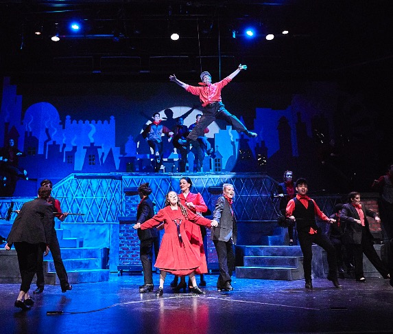 Senior Michael Gerardi soars above his fellow cast in Mary Poppins