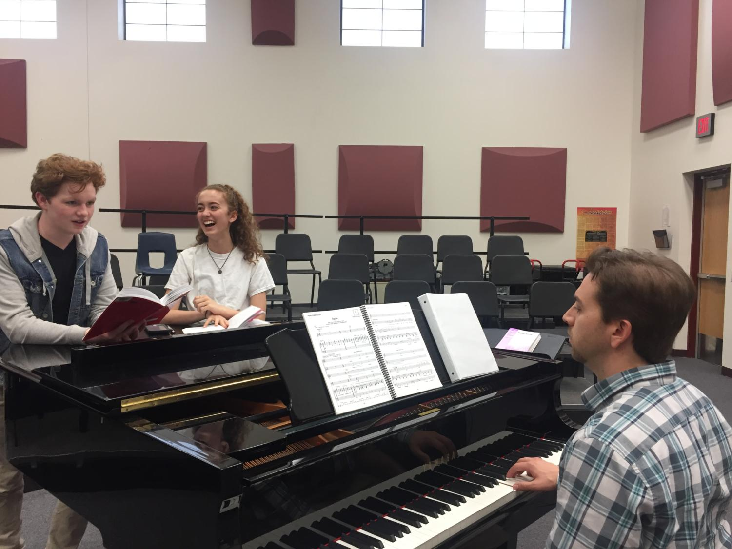 Two students who are playing a main role in the upcoming winter musical practice there music.