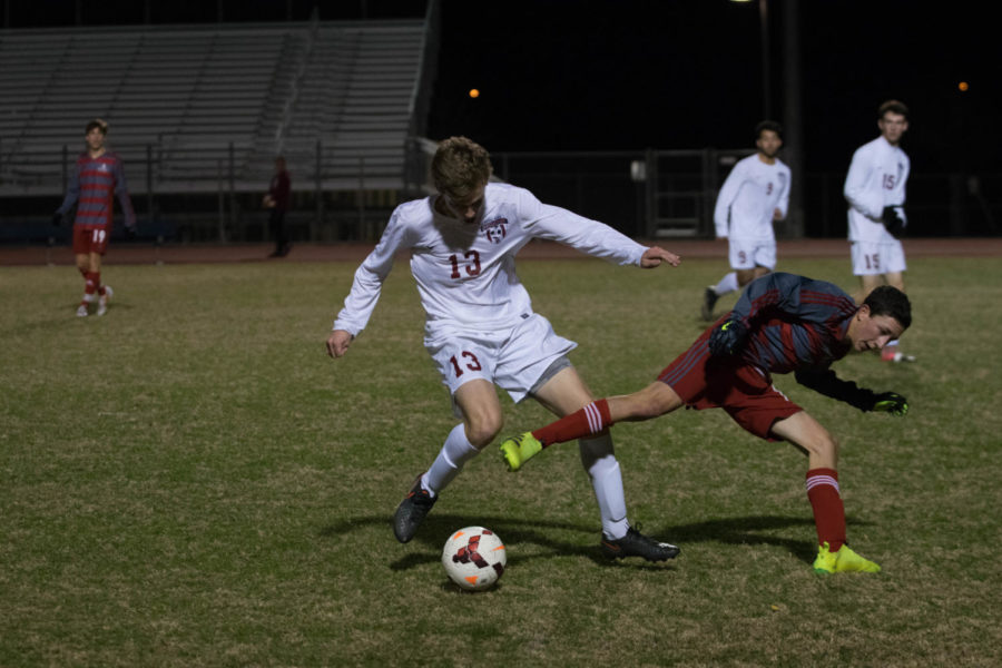 Senior Pearson Wallace shields the ball from his opponent.