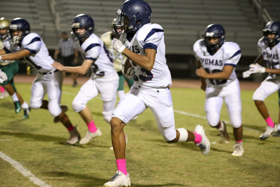 Sophomore #13 Zavier James running downfield with the ball during JV footballs games against Basha