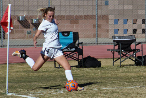 Current senior, Logan VanDine, kicks the ball to her teammates during the playoff game against Chandler on February 4th of last season.