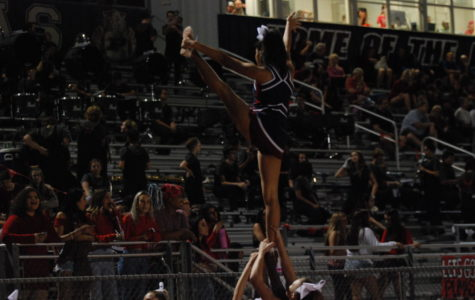 Cheer balances time on the sidelines and the mats