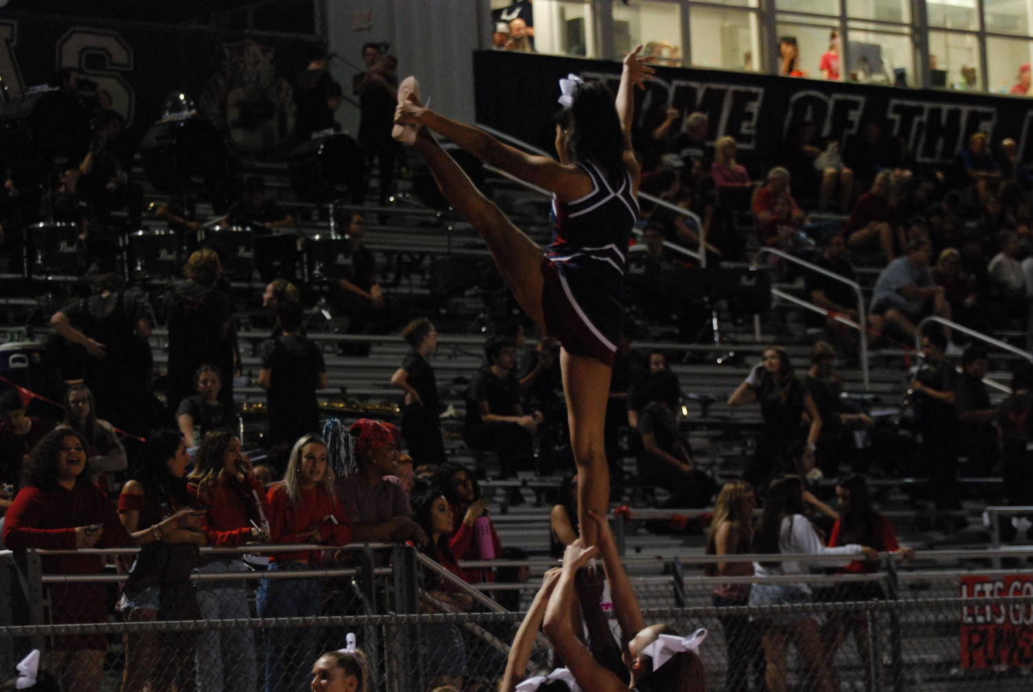 Lady Pumas hype up the crowd with high flying stunts, by Kayla Gee