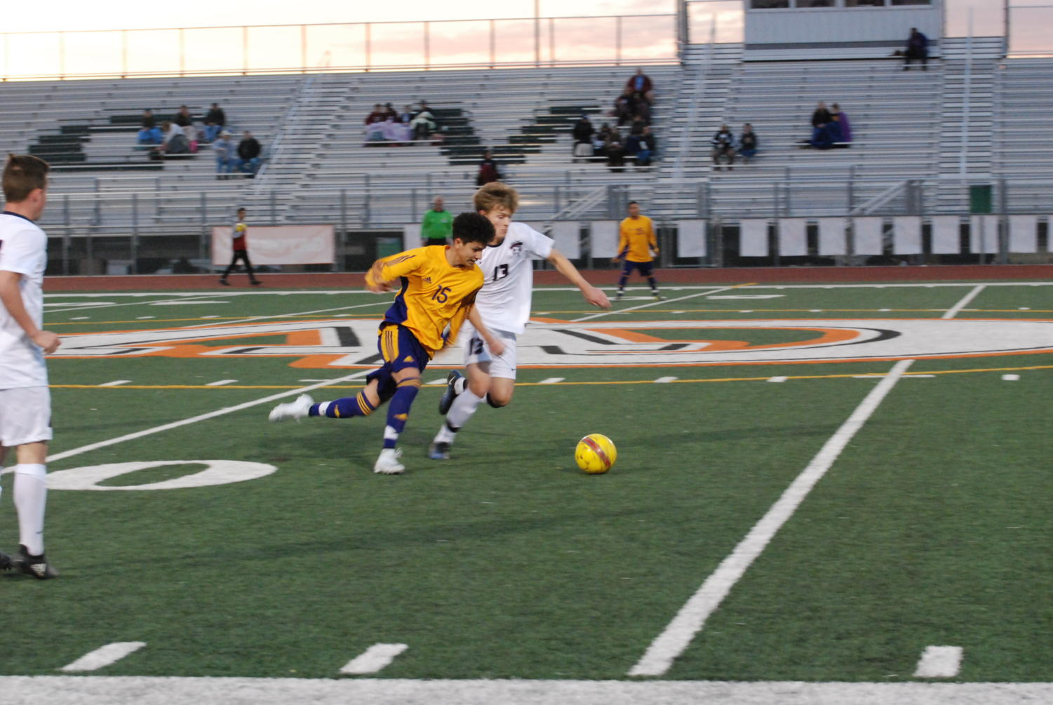 Senior Pearson Wallace (white) challenging a loose ball against Mesa.