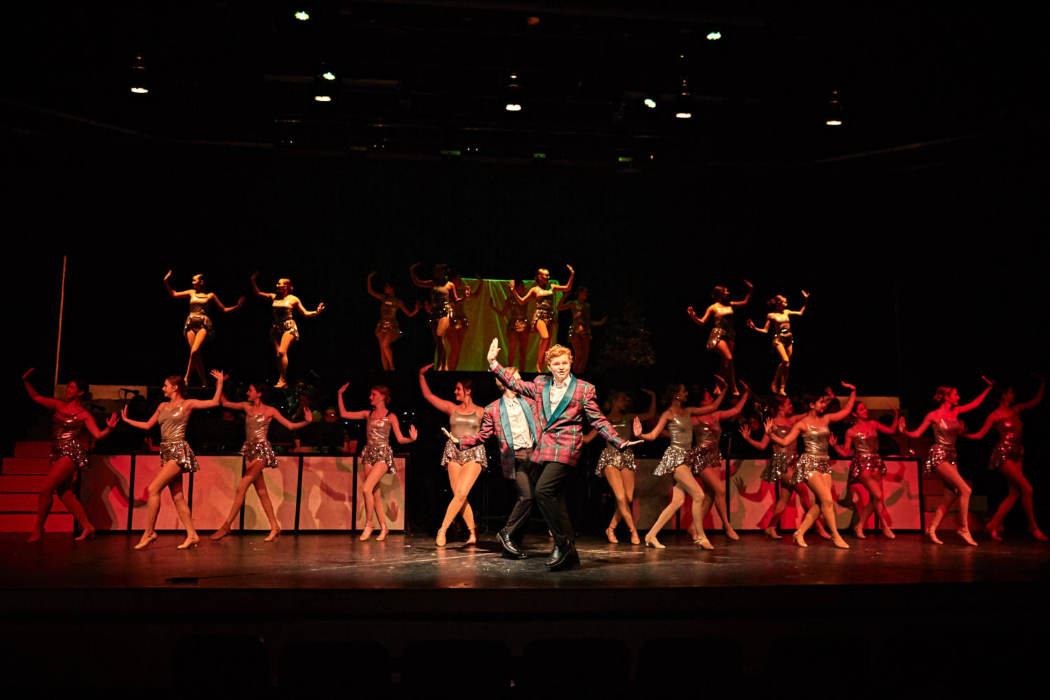 Moveo and the theatre company light up the stage in Act 1 of White Christmas, by Nick Woodward Shaw.