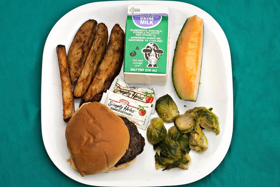 Lunch at DC Public Schools on 10/9/12: Local Beef Burger on a Whole Wheat Bun, Roasted Brussel Sprouts, Baked Potato Fries, Cantaloupe Wedge & Milk.