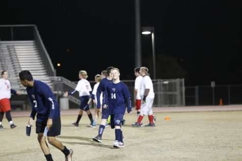 The unified soccer team takes the field in preparation for their game