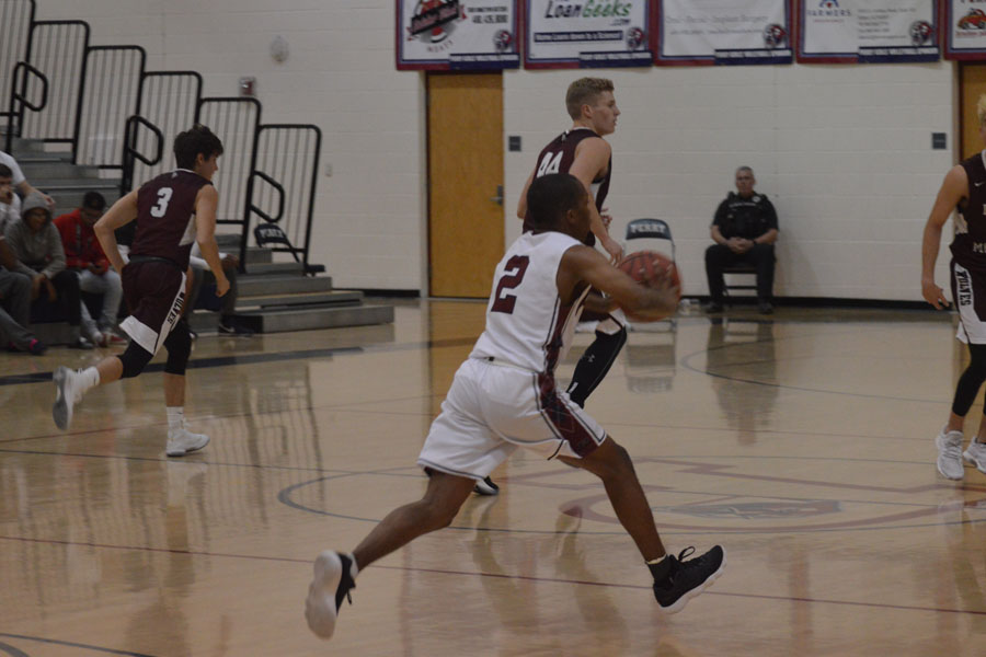 CJ Jamerson runs the court to pass the ball to fellow teammate