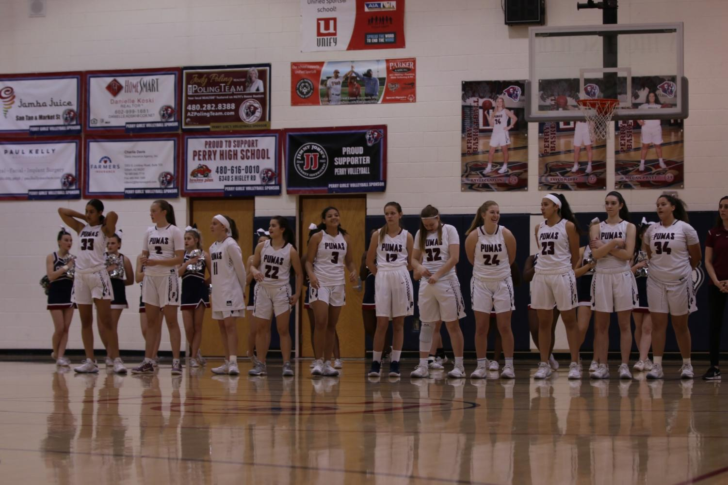 Perry Girls Basketball lines up to announce starting players.