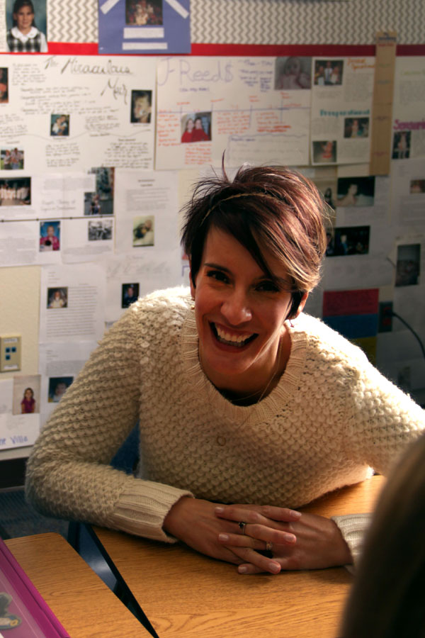 Psychology teacher Jocelyn Dolan radiates with happiness in her classroom in the bus barn.