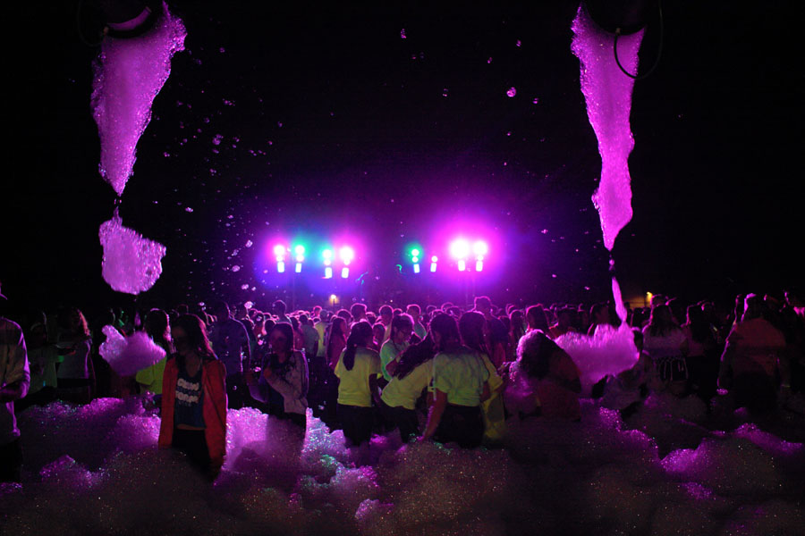 Students dance in the foam at the 'Glow Foam' dance on Fri. March 2.