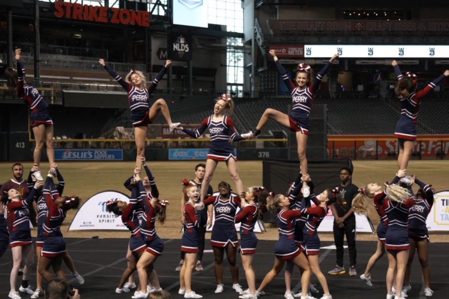 Varsity+cheerleading+owned+the+competition+with+the+all+girls+show+cheer+and+the+five+man+performance+at+state+before+nationals+in+Anaheim%2C+California.+