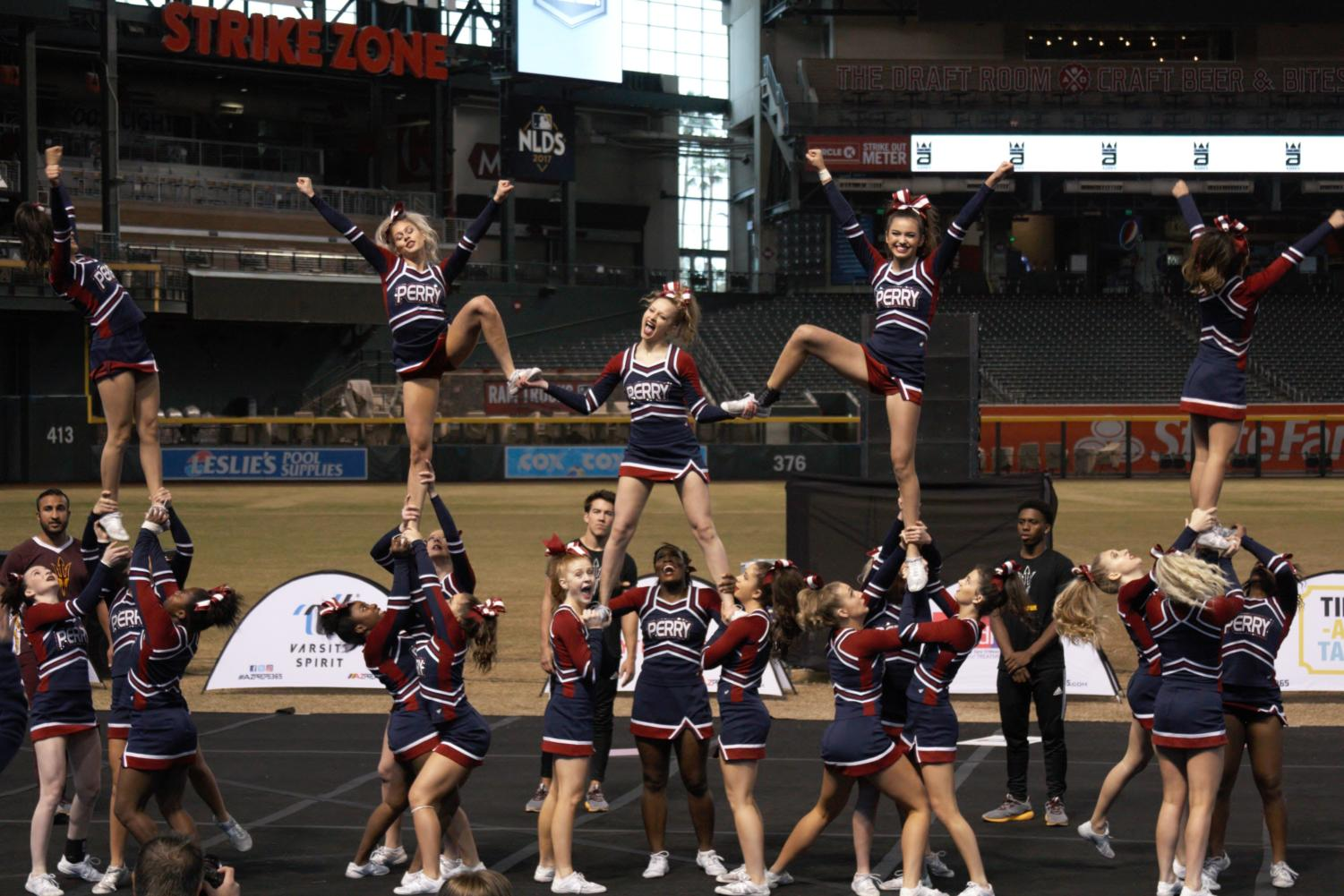 Varsity cheerleading owned the competition with the all girls show cheer and the five man performance at state before nationals in Anaheim, California.