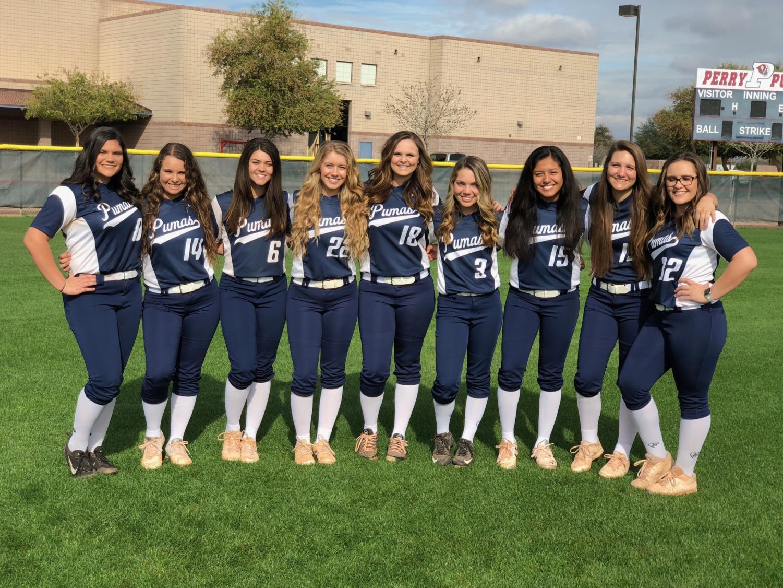 Softball team stands united
