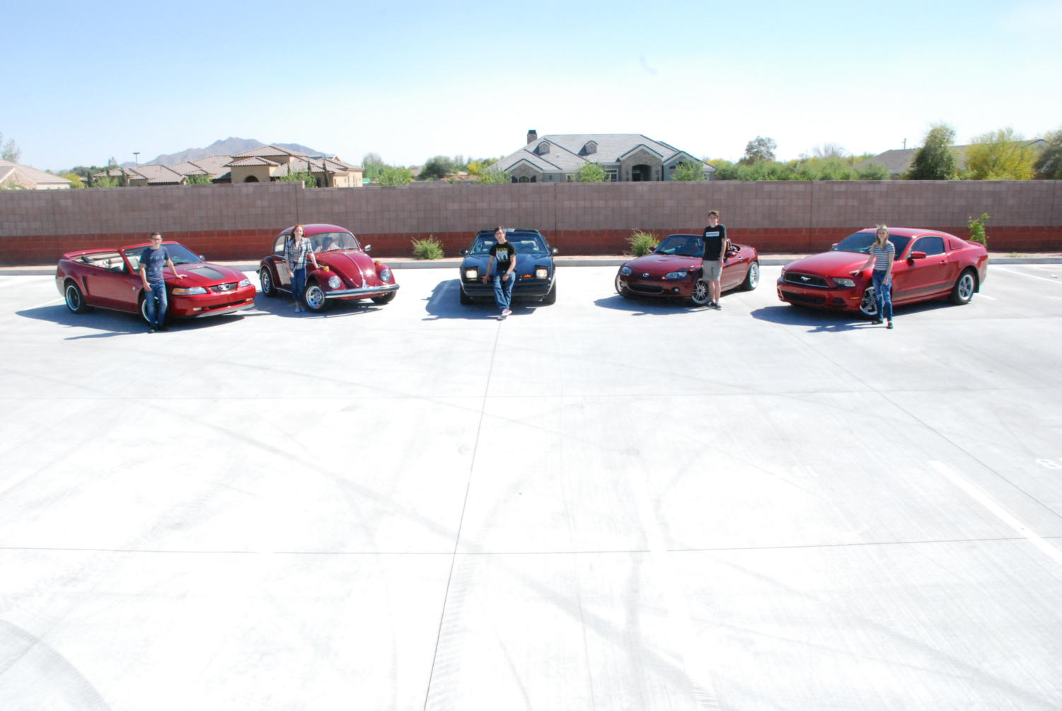 Left to right: Jakob Shapiro and his '99 Mustang GT; Isabela Olivarez and her '75 Beetle; Andy Gongora and his '89 Firebird; Andrew Drake and his '09 Miata MX-5; Bailey Davis and her '14 Mustang
