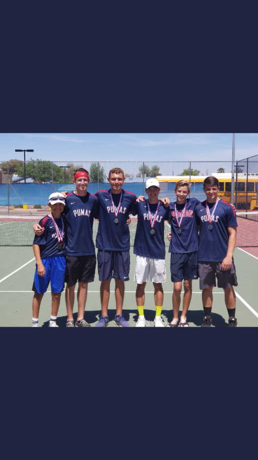 The+varsity+tennis+team+members+pose+for+a+picture+after+winning+all+six+singles+silver+medals+and+all+three+doubles+silver+medals.+The+Pumas+finished+second+overall.