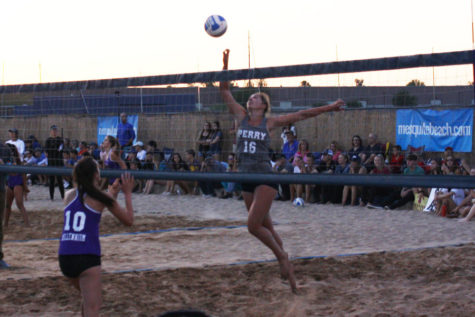Senior Portia Valadez spikes the ball against Mesquite High in the state championship match