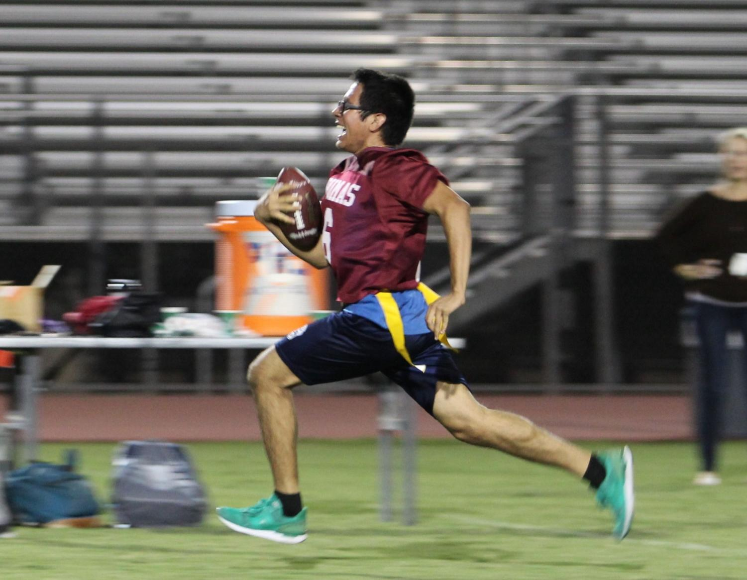 Senior David Salano carries the ball for a touchdown
