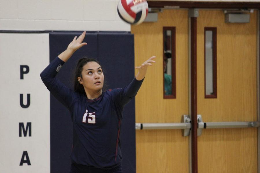 Senior setter Madison Beasley serving the ball against Queen Creek High