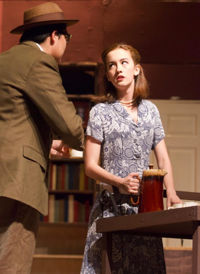 Senior, Emily Wright, playing as Elsa Von Grossenknueten, and Junior, Manuel Edrozo playing as Michael Kelly in The Musical Comedy Murders of 1940. Wright looks at Edrozo with a striking glare during an informative conversation that adds plot and mystery to the play.