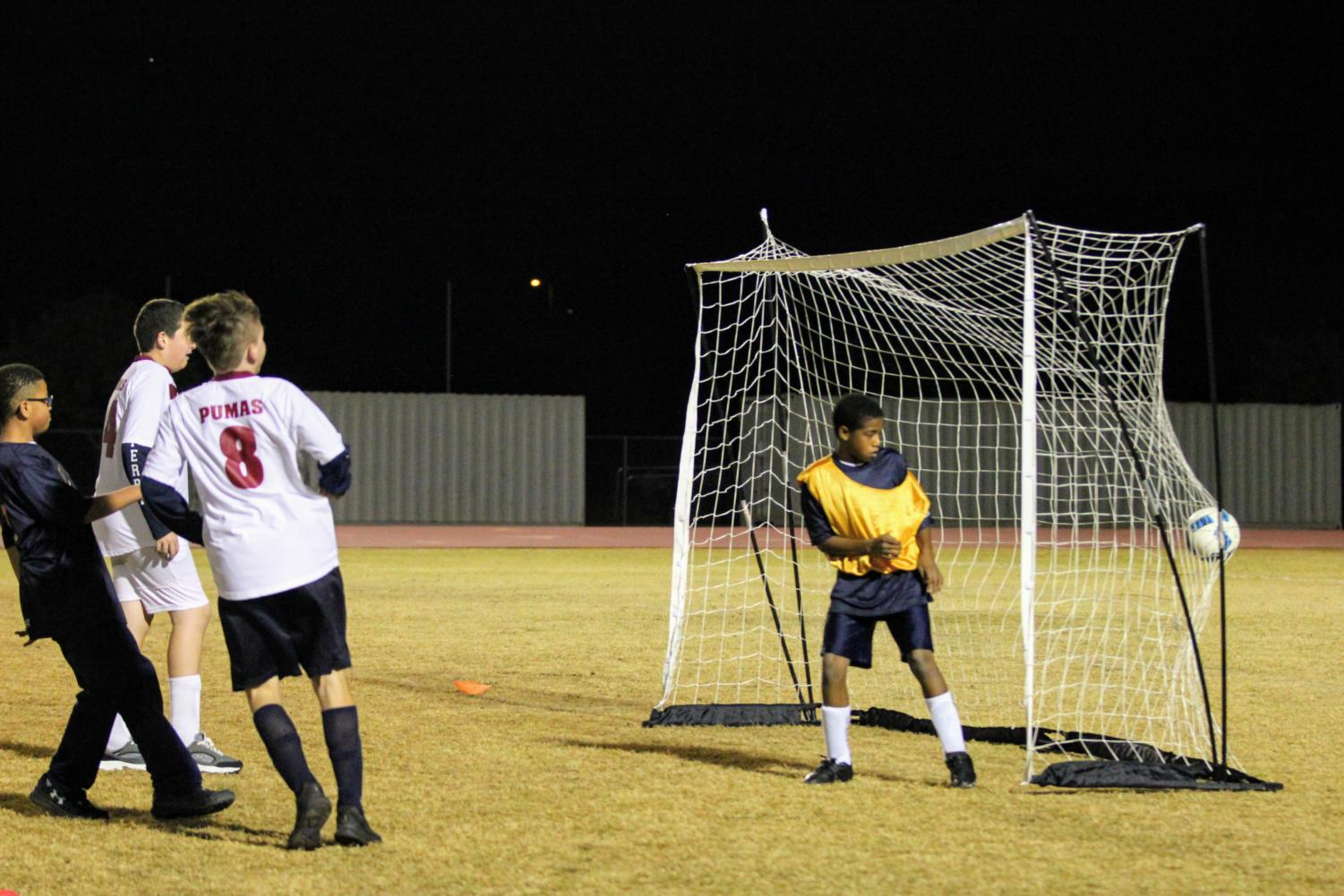 Junior Adam Baumgarth scores a goalin the unified soccer game against Casteel High school on December 5.