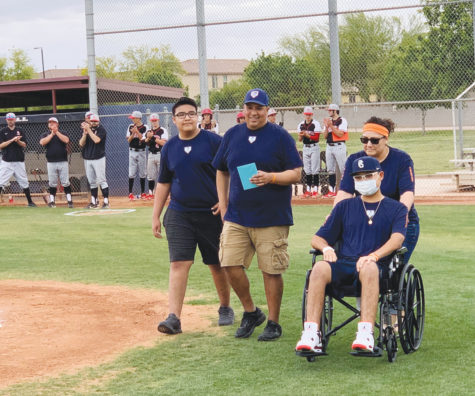 Senior Jacob Medina, in his wheelchair, makes an appearance at baseball's senior night with his family on April 16. Medina, who was diagnosed with Leukemia in March, says he has been amazed with the support he has received from the community.