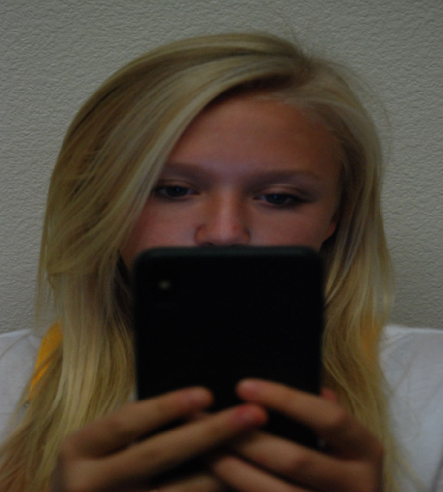 Kenna Cassey is just one of many students who uses their phone in class.