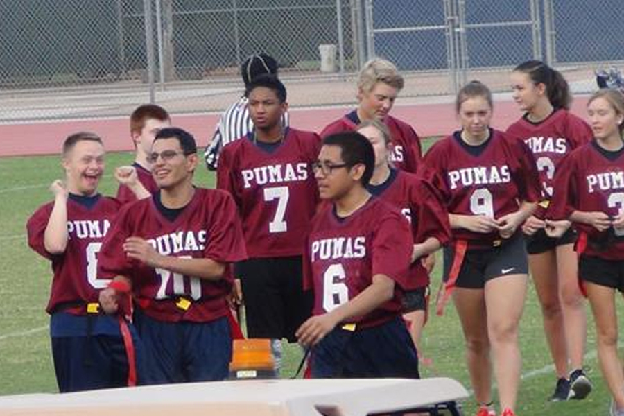 Unified flag football players walking off the field.