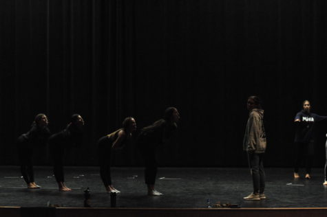 Moveo dancers practicing in auditorium. The ladies are working hard.