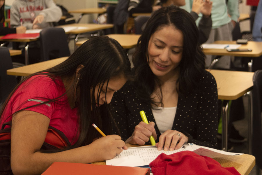 Norma Rios is seen helping an ELL student with homework. She works with the ELLs at the end of each school day.