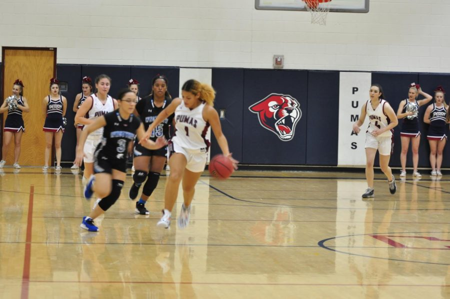 Tatyanna Clayburne dribbles a ball down the court at a recent game.